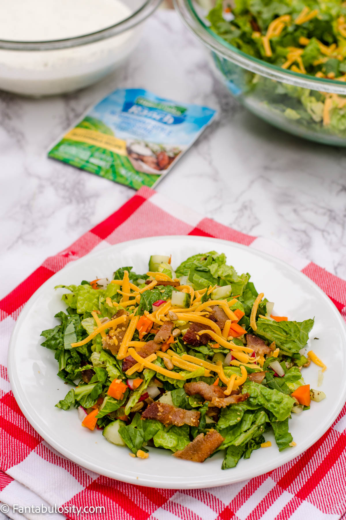 Salad ingredients on plate with dressing on the side