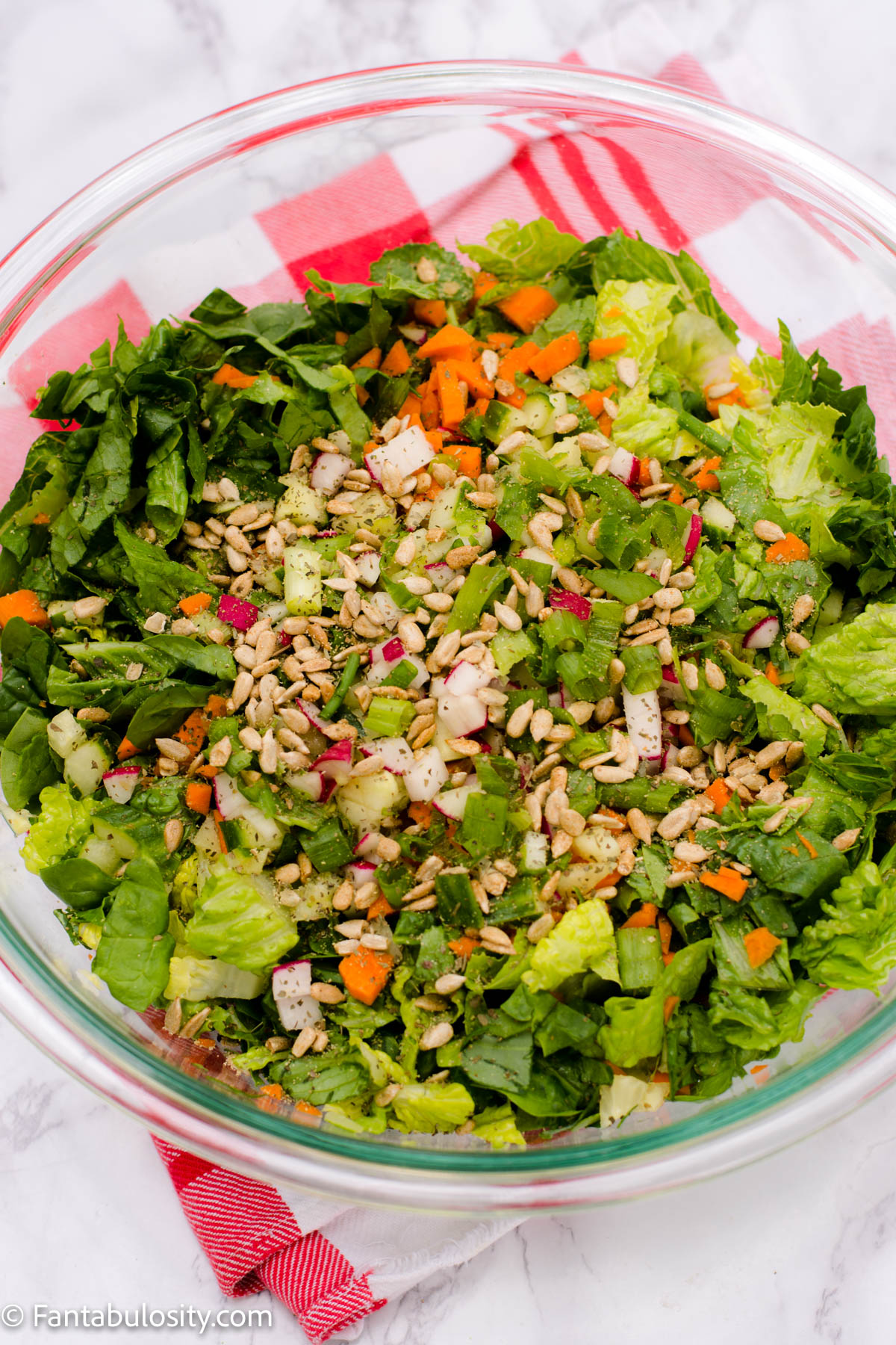 Side salad with toppings in clear bowl