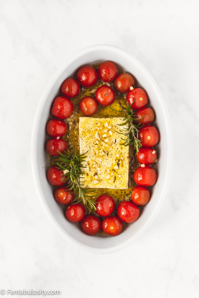 Feta, oil, spices and tomatoes for baking pasta