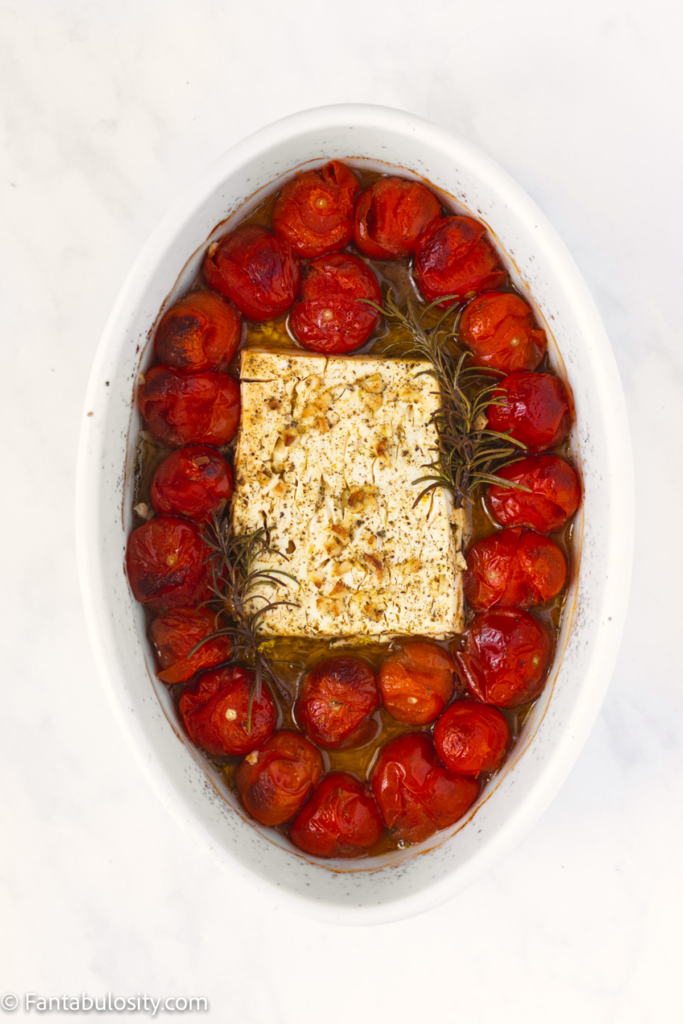 Baked tomatoes and feta cheese in baking dish