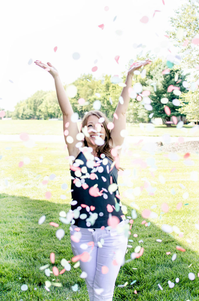 Throwing confetti in the air - jessica burgess