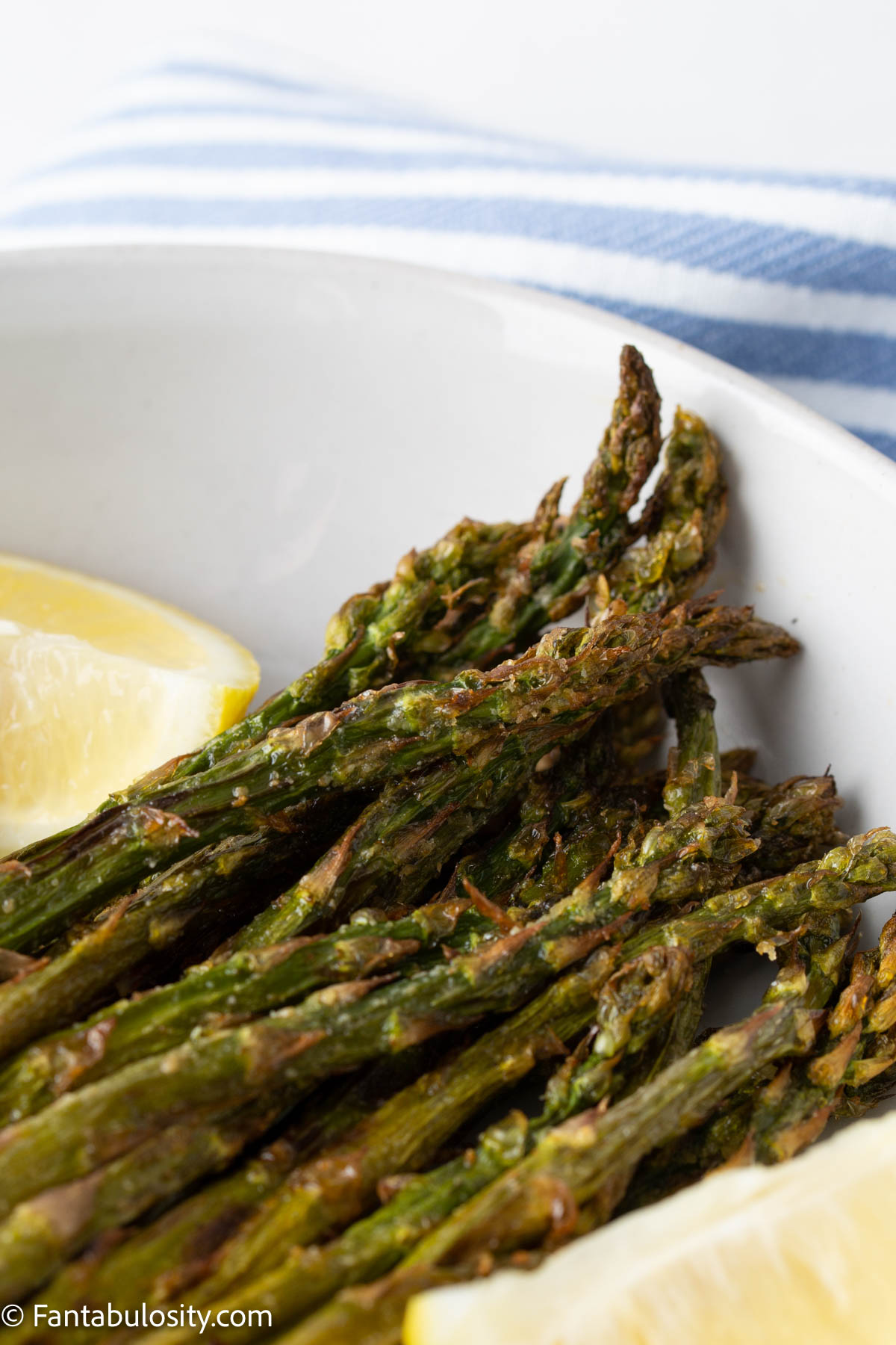 asparagus in the air fryer on white plate