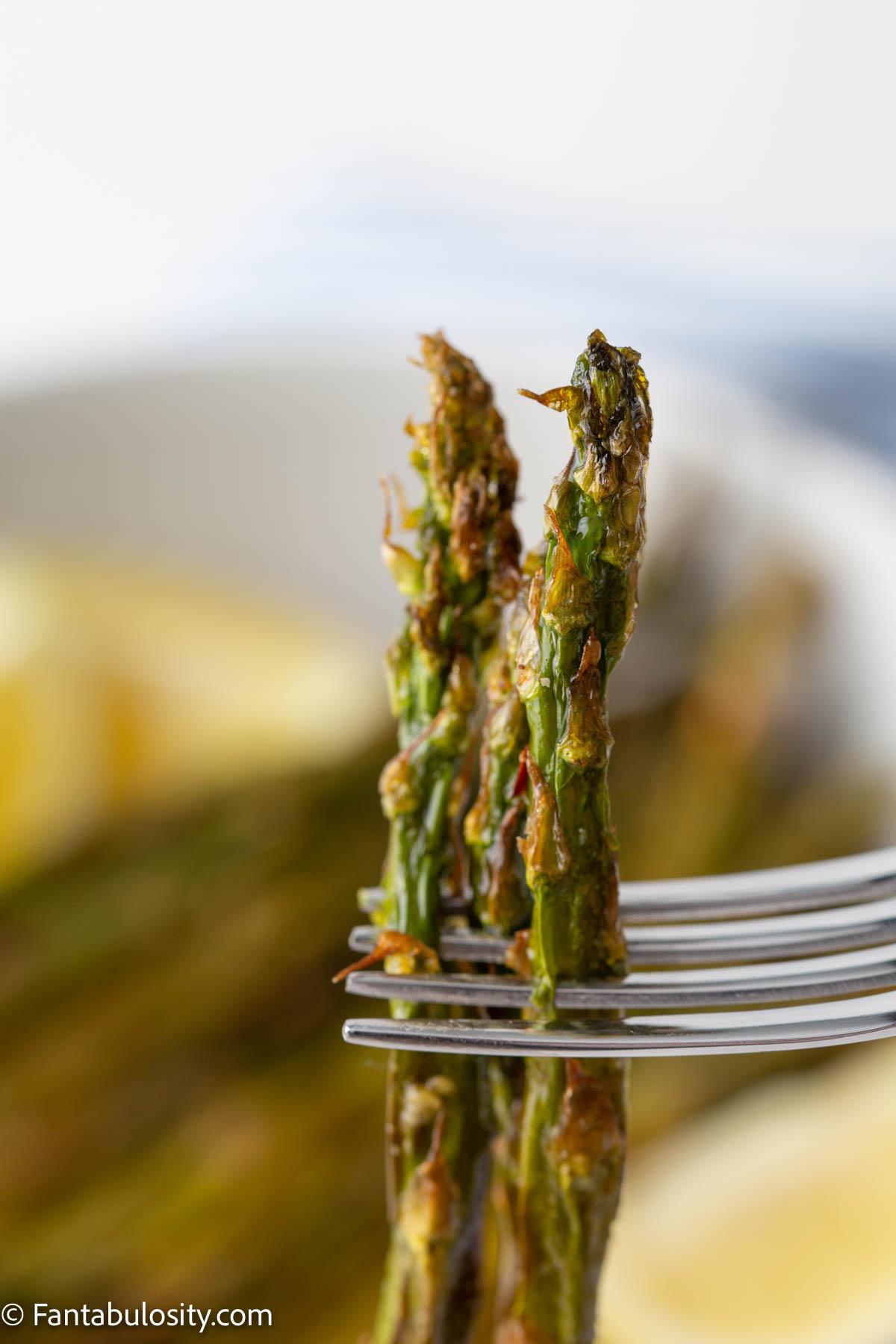 healthy air fryer asparagus on a fork, close-up