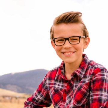 Boy wearing Befitting Rayban eyeglasses
