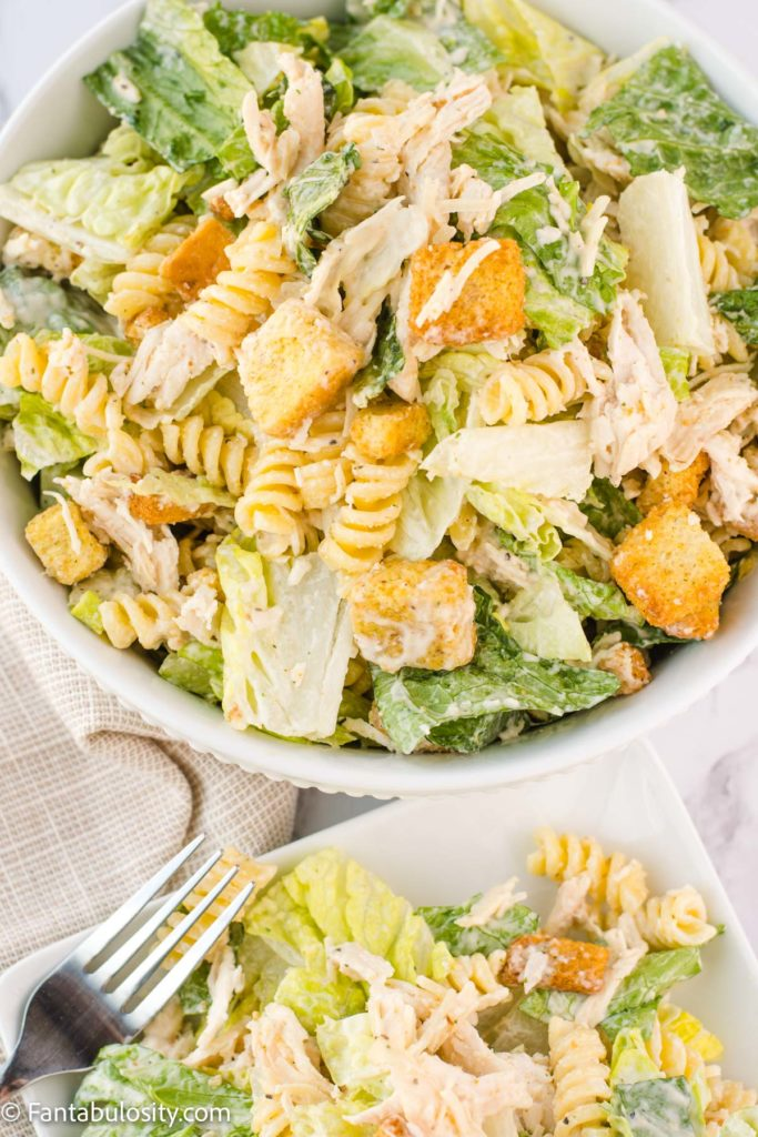 Chicken Caesar Pasta Salad Recipe in a bowl with a cloth