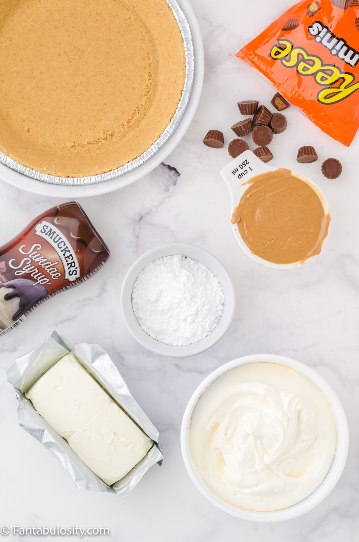 Ingredients on white table for peanut butter pie