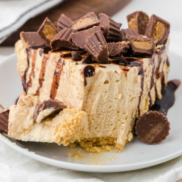 Old fashioned peanut butter pie on plate with bite on fork
