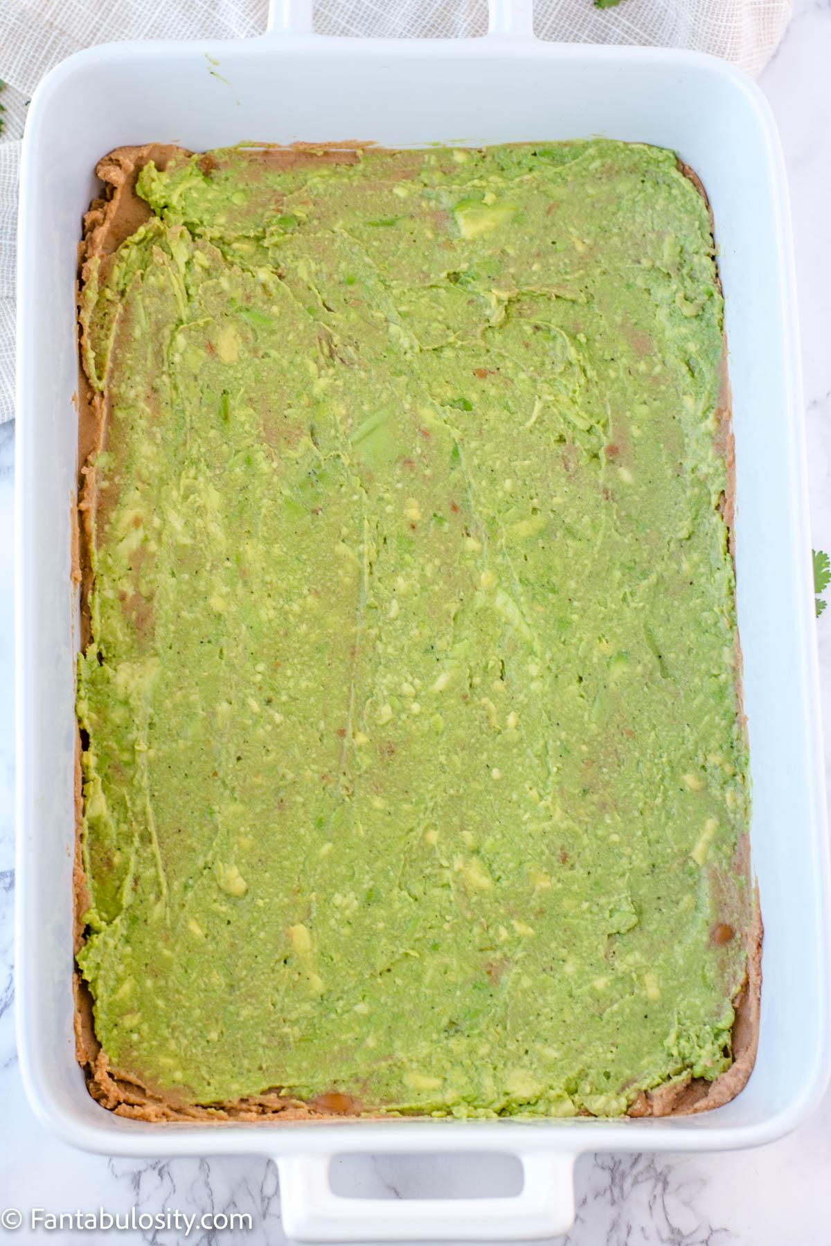 spread mashed avocado or guacamole in dish