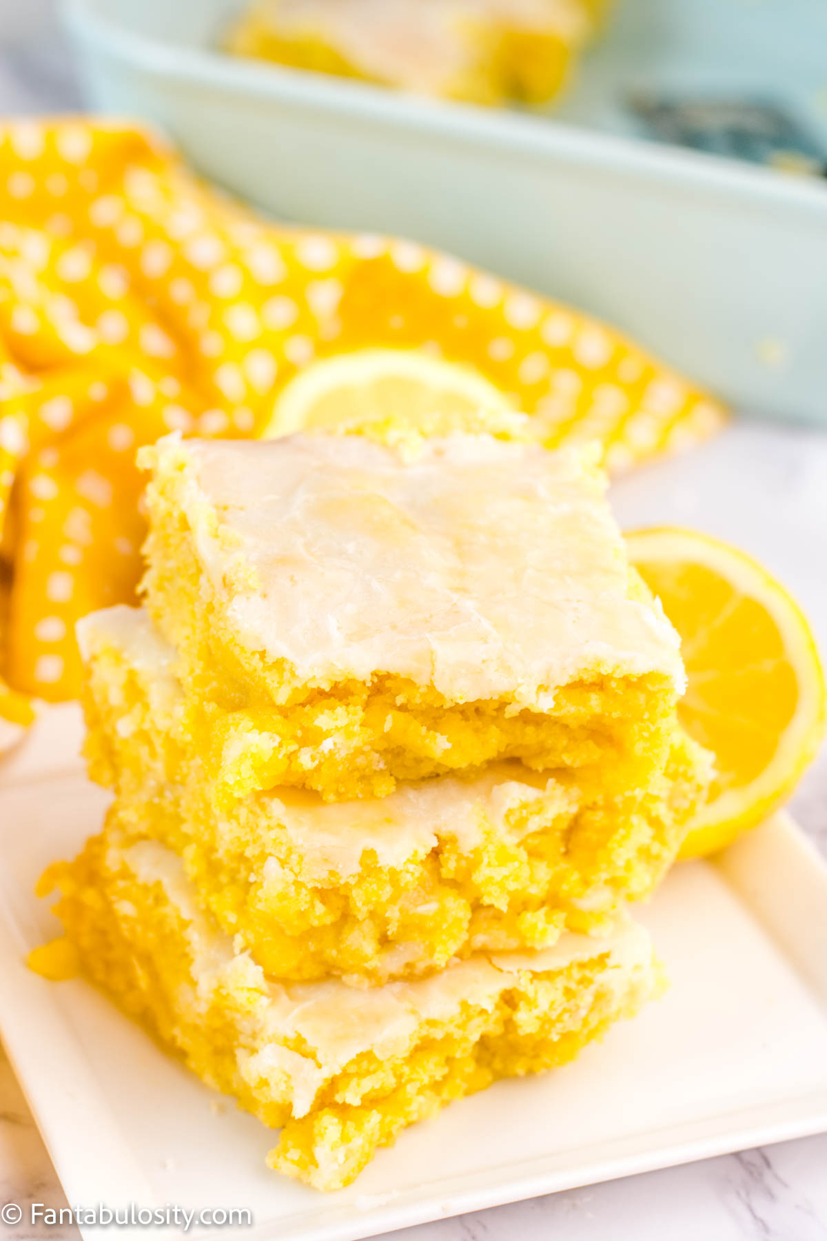 Lemon Brownies Stacked on white plate