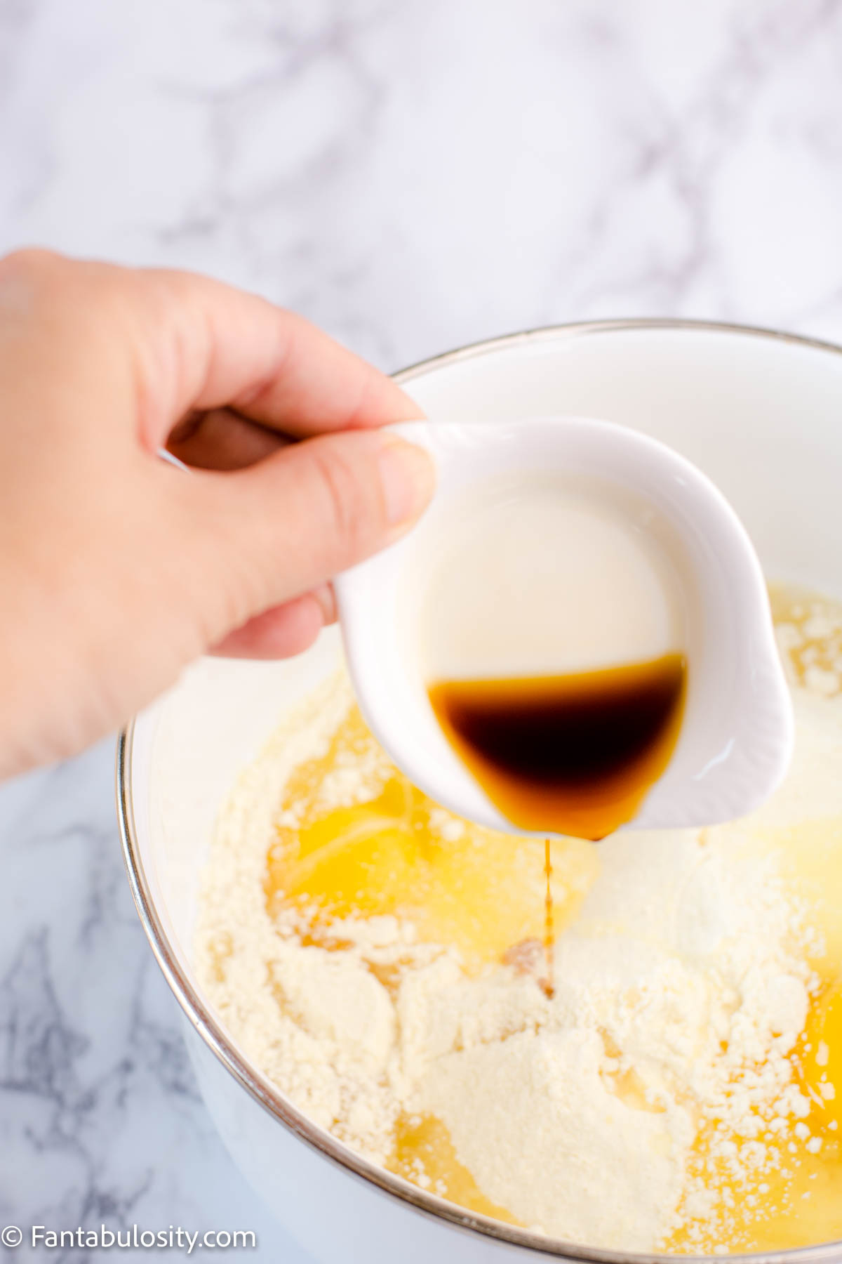 Pour vanilla in to cake mix