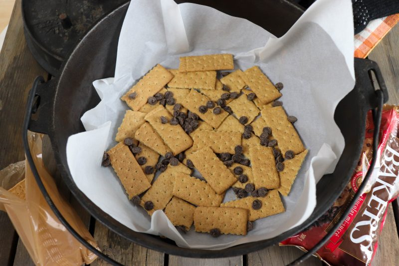 graham crackers and chocolate chips in cast iron for smores
