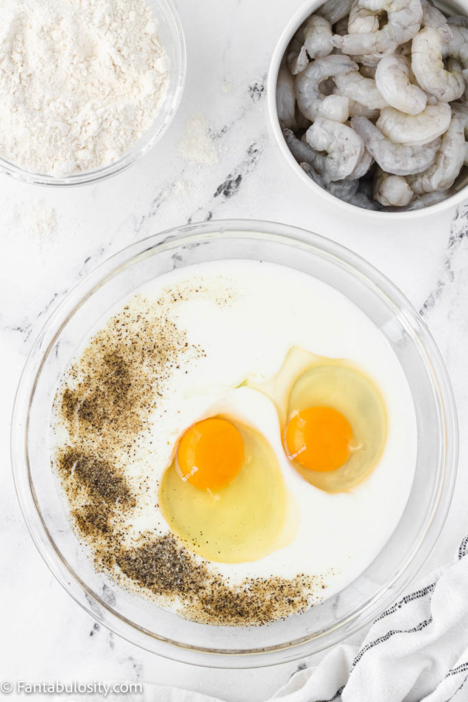 Mixing together eggs, milk and spices