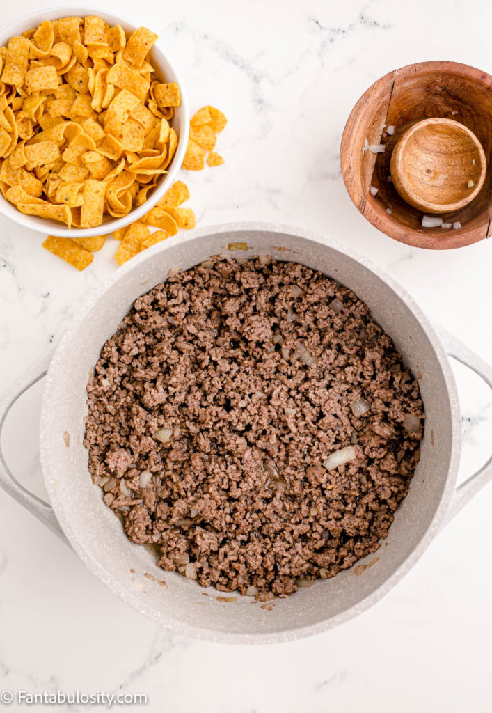 Add cooked ground beef in to pot