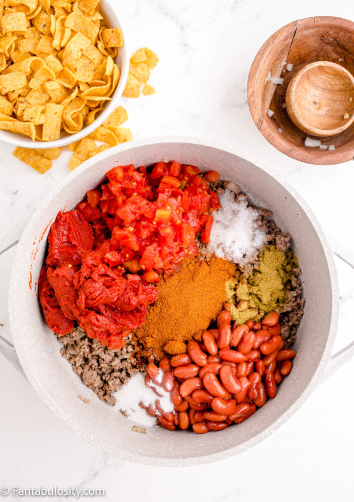 Add in chili beans, tomatoes, and more