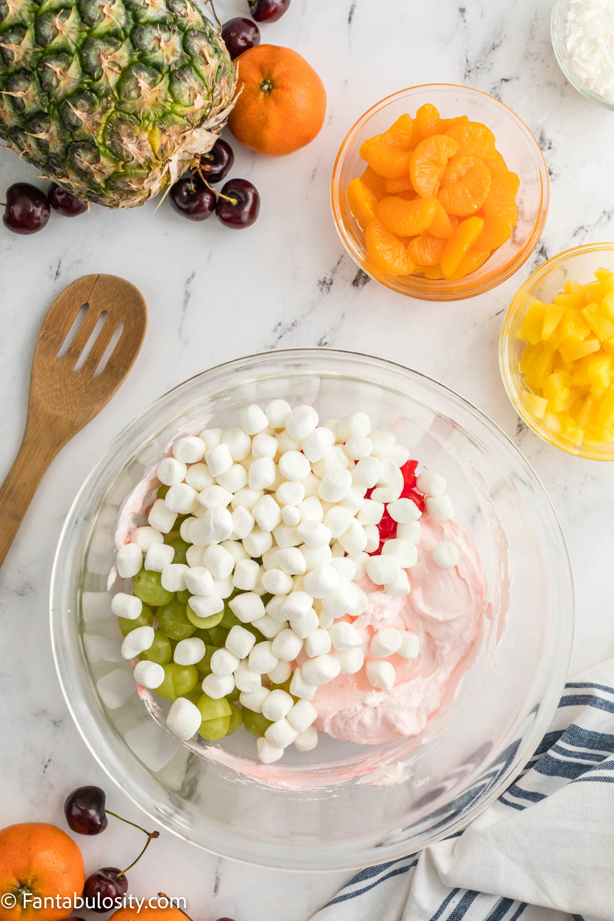 Add in marshmallows to fruit salad