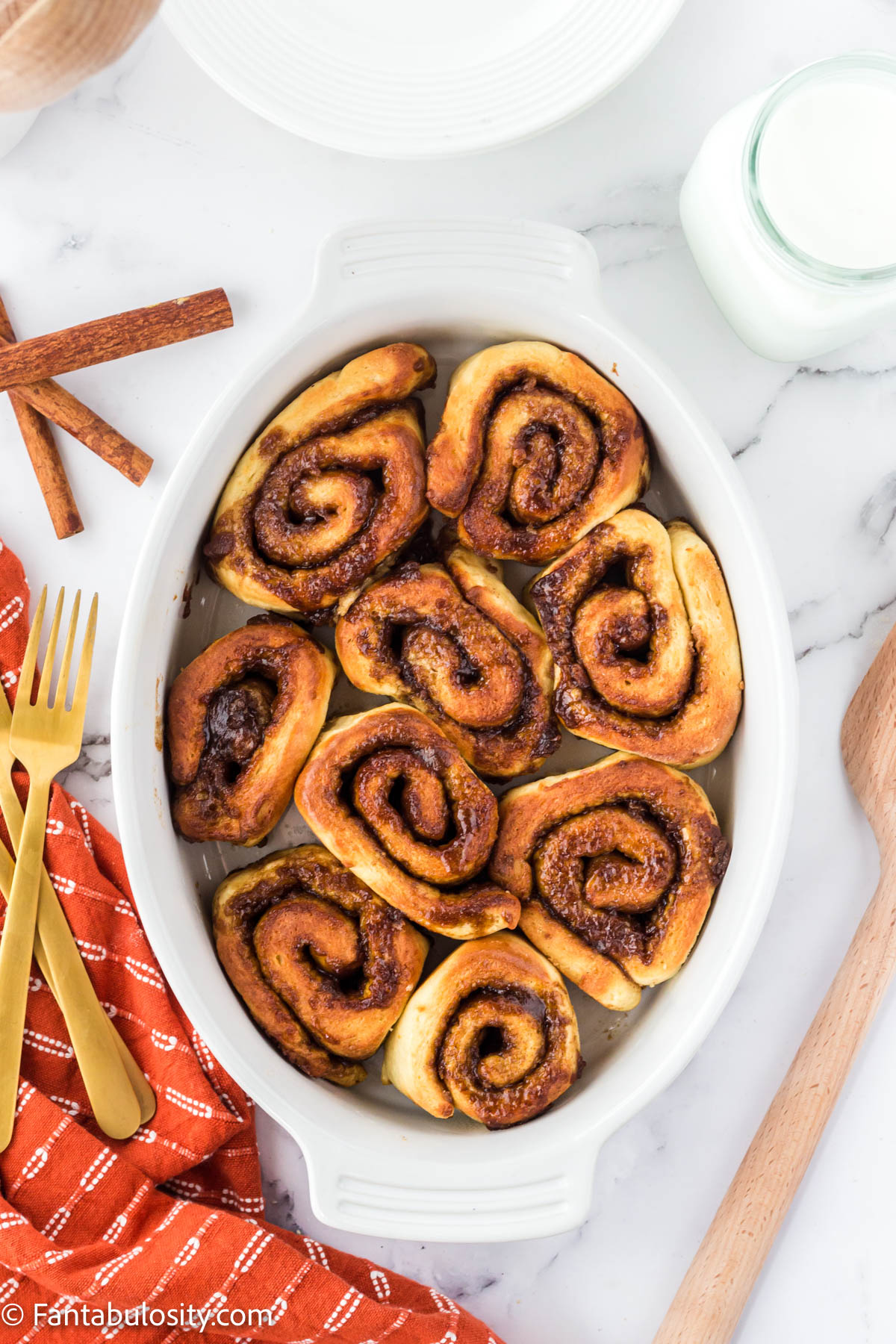 Cooked air fryer cinnamon rolls in white dish