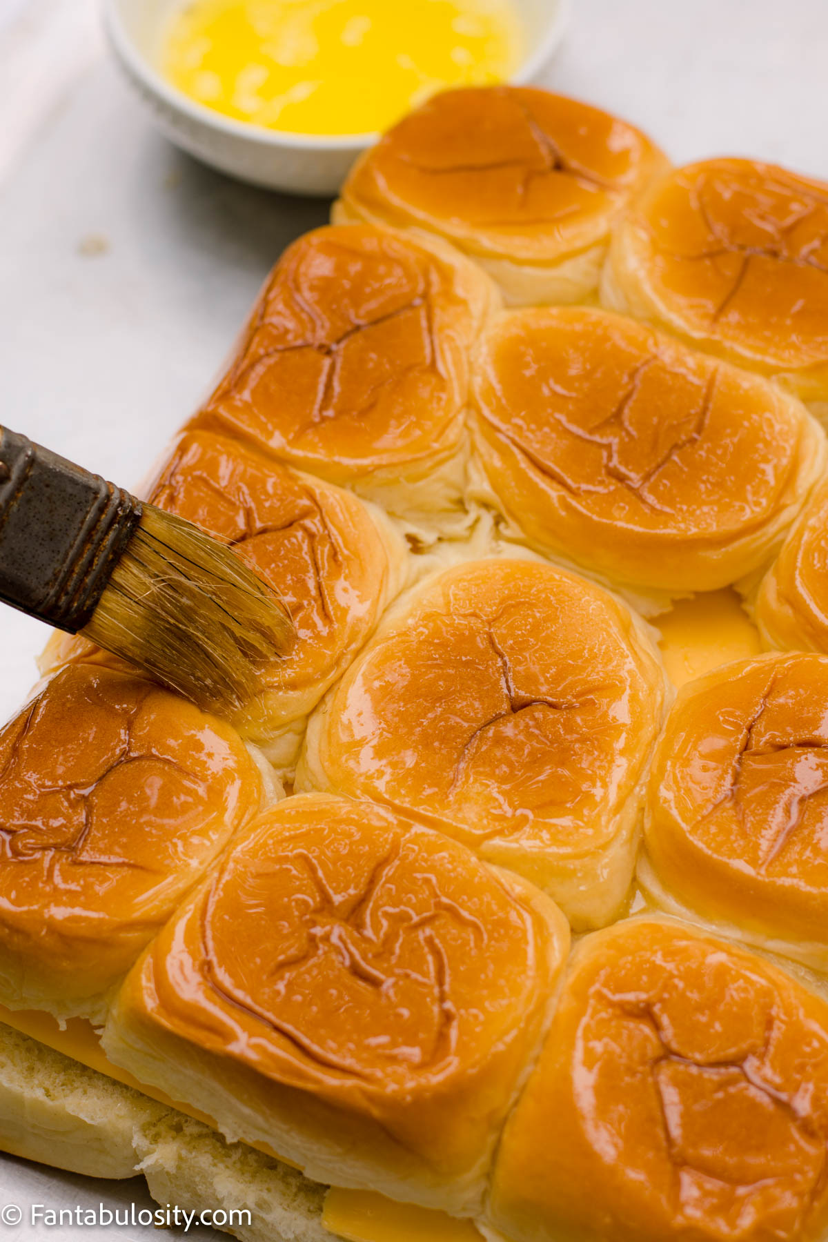 Brush garlic cutter on top of rolls