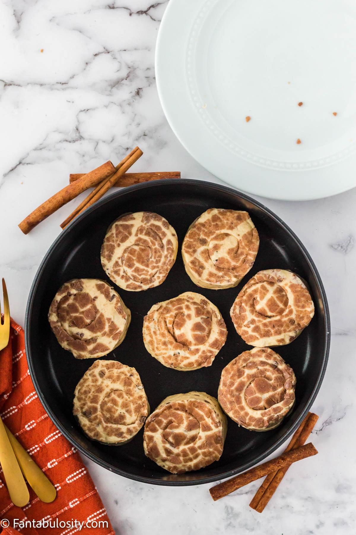 raw pillsbury cinnamon rolls in air fryer basket